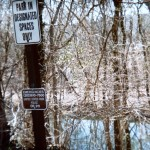 Signs on the rock creek.