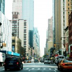 One way streets are surrounded by big and bigger buildings and the one constant are NYC cabbies everywhere.