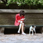A lady and her dog outside of Central Park